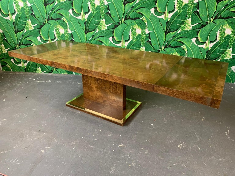 Burled elmwood dining table by Founders furniture for Thomasville, circa 1975. Includes two leaves, full table pads, and protective leaf storage covers. Each leaf measures 16.25