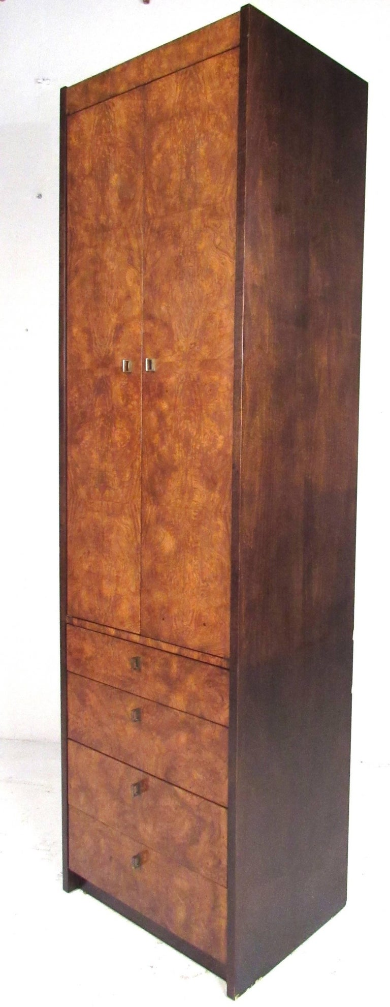 Beautiful, narrow and tall, burl wood cabinet by Century Furniture. Well constructed with four storage drawers below and large shelf storage compartment above. Please confirm item location (NY or NJ) with dealer.