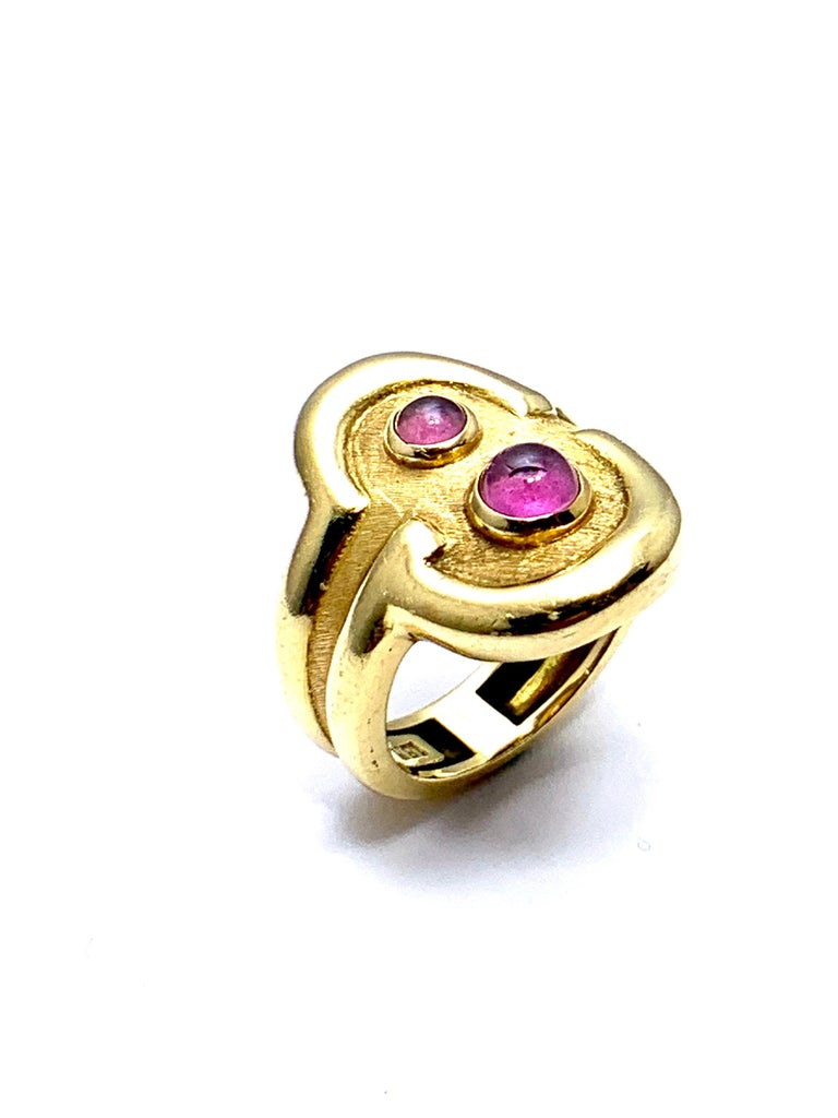 A beautiful Pink Tourmaline ring designed by Burle Marx. The 0.48 carat cabochon Pink Tourmaline displays a light pink hue, bezel set in an 18 karat yellow gold abstarct design ring. The inside shank is signed