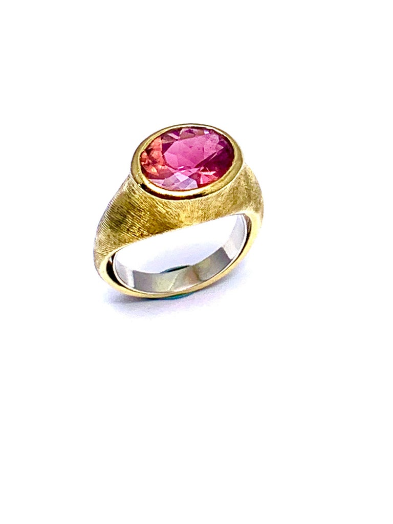 A beautiful Pink Tourmaline ring designed by Burle Marx. The 3.57 carat faceted oval Pink Tourmaline displays a light pink hue, bezel set in an 18 karat yellow gold abstarct design ring. The inside shank is signed
