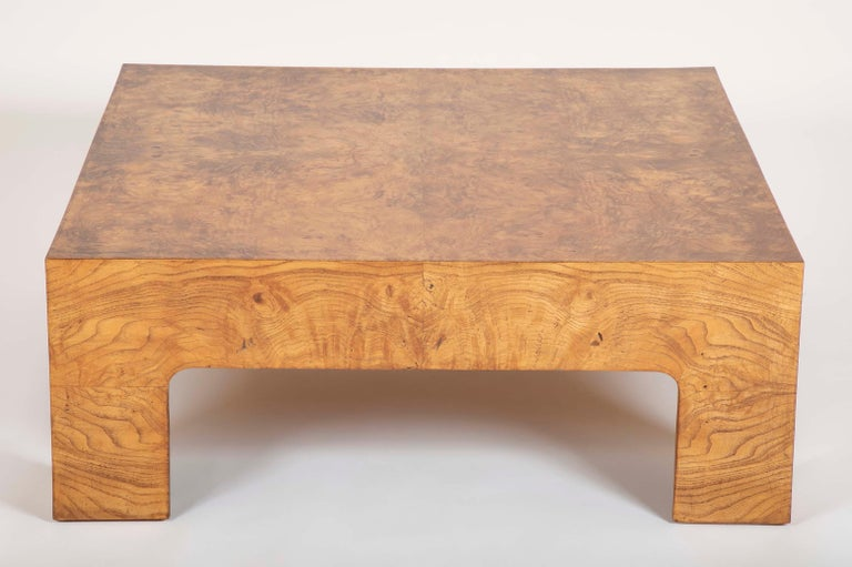 A Parsons style burled elm coffee table in the manner of Milo Baughman.