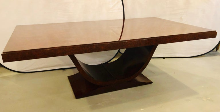 Burled walnut Art Deco inspired dining table by Aerin Lauder. Designed by Aerin, this elegant Art Deco silhouette defines this gorgeous table. Featuring a rich cocoa finish, hand rubbed to a satin soft gloss. Clean lines with sleek curves, this