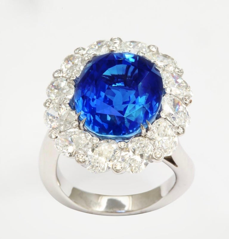 The beauty of ovals is perfectly expressed in this exquisite ring.   The central oval sapphire (Gübelin certificate Burmese origin, no heat treatment) weighs 15.38cts. 12 oval diamonds are beautifully set on an angle and weigh a total of 3.74cts. 24