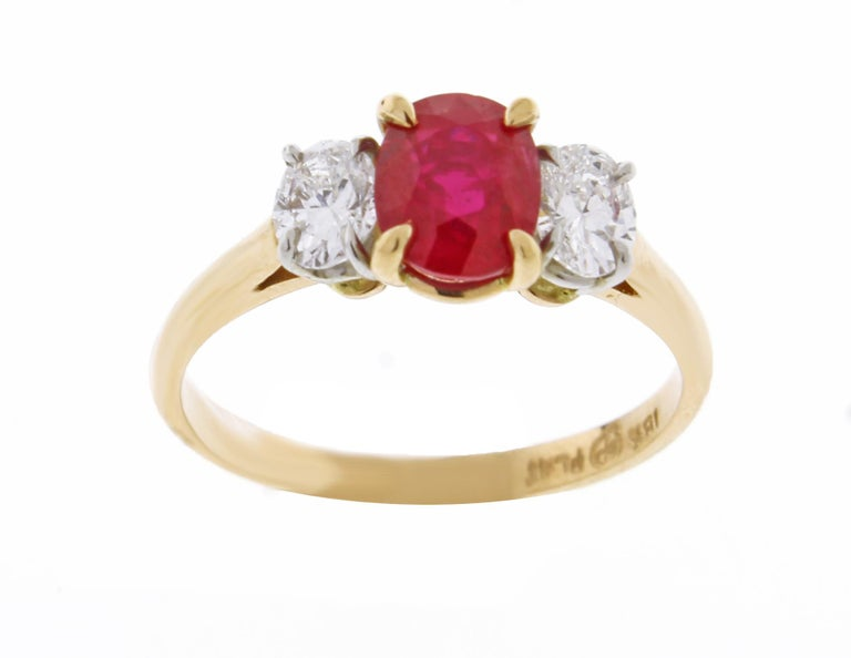 From Pampillonia jewelers an oval Burma ruby and diamond hand made ring. ♦ Designer :Pampillonia ♦ Metal: 18 karat and platinum ♦  Oval ruby =1.08 carats A.G.L certified Burma non heated ♦ 2  Oval diamonds=.45 carats F color VS clarity ♦ Circa
