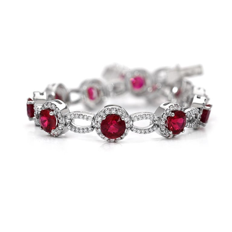 Sensational 9.18 carats total Burmese Ruby rounds, and 1.90 carats total of round brilliant diamonds are hand set in this important platinum diamond bracelet. 6.75 inches long. This Burma Ruby set is superior in color, clarity and cut.  Returns are