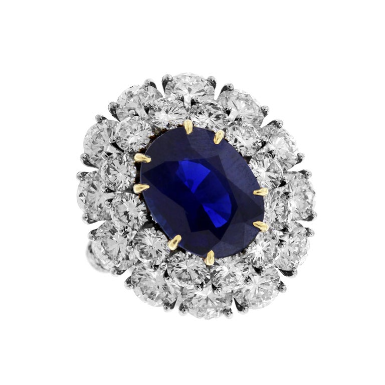 Platinum Ring with GIA Certified No-Heat Burma Sapphire center and Diamonds  This No-Heart, Burma, GIA Certified Blue Sapphire is truly remarkable and for a collector. It is a 5 carat oval-cut and measures 11.31mm x 9.17mm x 5.17 mm. GIA Report #: