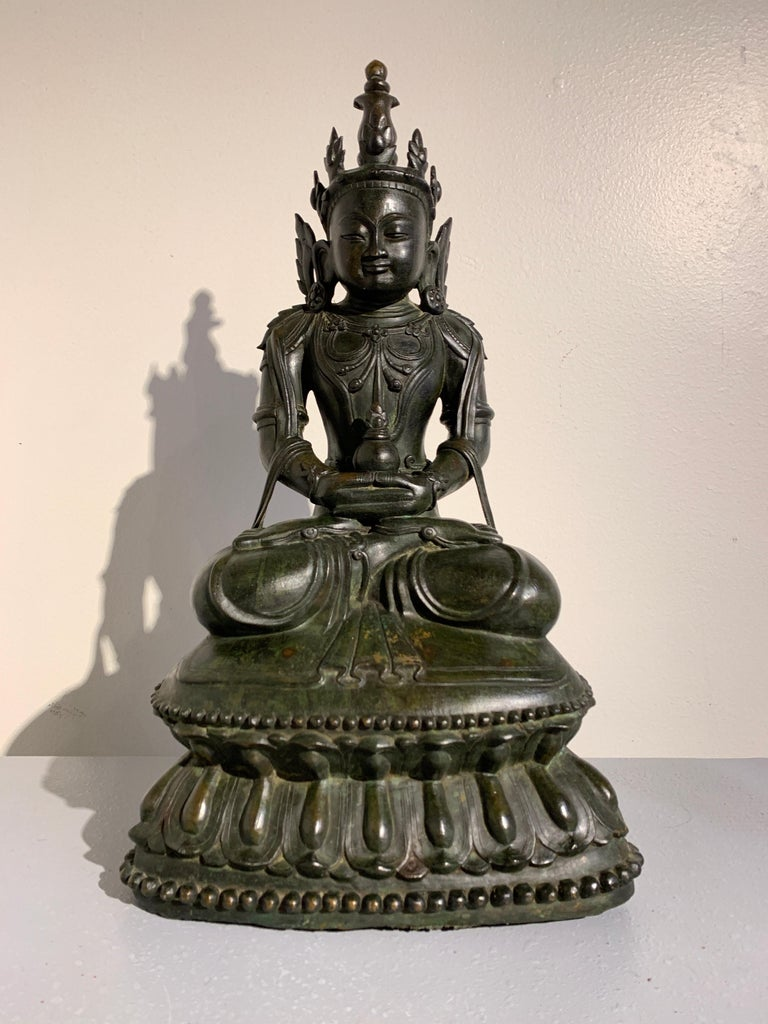 A gorgeous and refined Burmese crowned and adorned seated bronze Buddha, Kingdom of Arakan, Mrauk-U period, 17th century. 