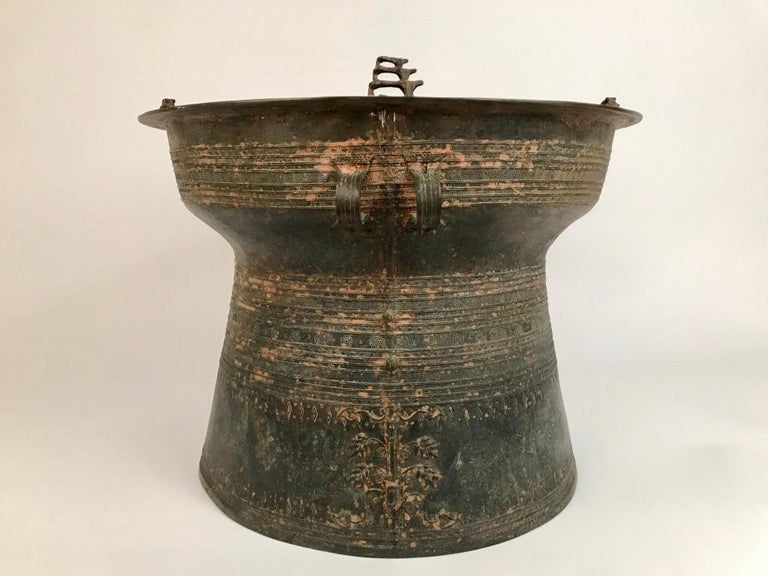 Burmese bronze Karen rain drum with intricate decoration on the top and around the body of the drum with four triple piggy-backed frogs on the Tympanum and elephants and lizards in relief on the sides. These drums are also referred to as frog drums