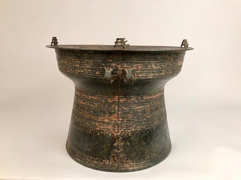 Burmese bronze Karen rain drum with intricate decoration on the top and around the body of the drum with four triple piggy-backed frogs on the Tympanum and elephants in relief on one side. These drums are also referred to as frog drums and have been