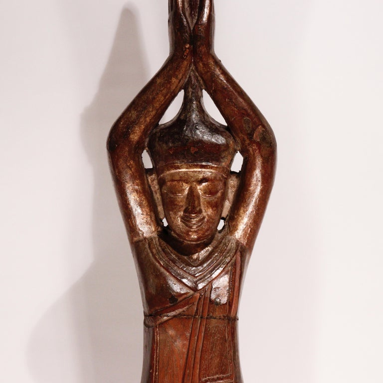 Burmese carved solid wood image of the Hermit Sumedha, known for lying down and stretching his body thin before the Dipankara Buddha, using his body as a bridge so that the Buddha would not have to walk in the mud and who in turn prophesied that