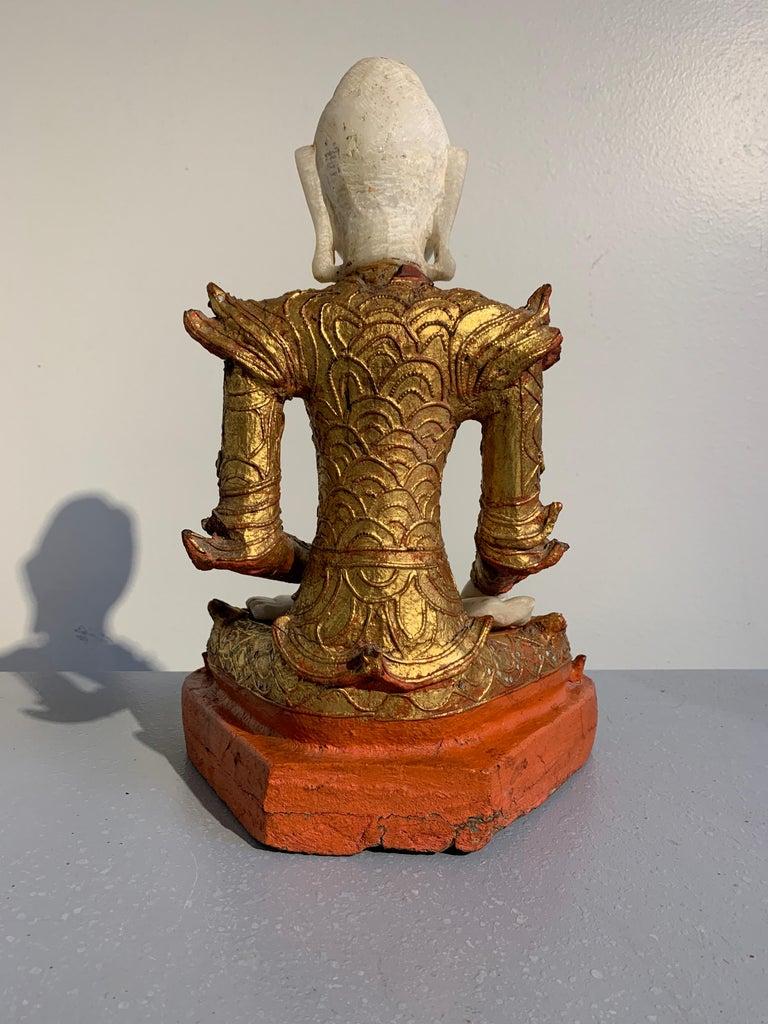 Burmese Mandalay Buddha in Royal Attire, Alabaster, Gilt Lacquer and Teak In Fair Condition In Austin, TX