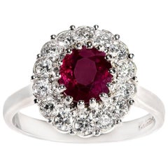 Burmese Oval Ruby and Brilliant Cut Diamond Cluster Ring in 18 Carat White Gold