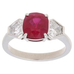 Burmese Ruby and Diamond Three-Stone Engagement Ring Set in Platinum