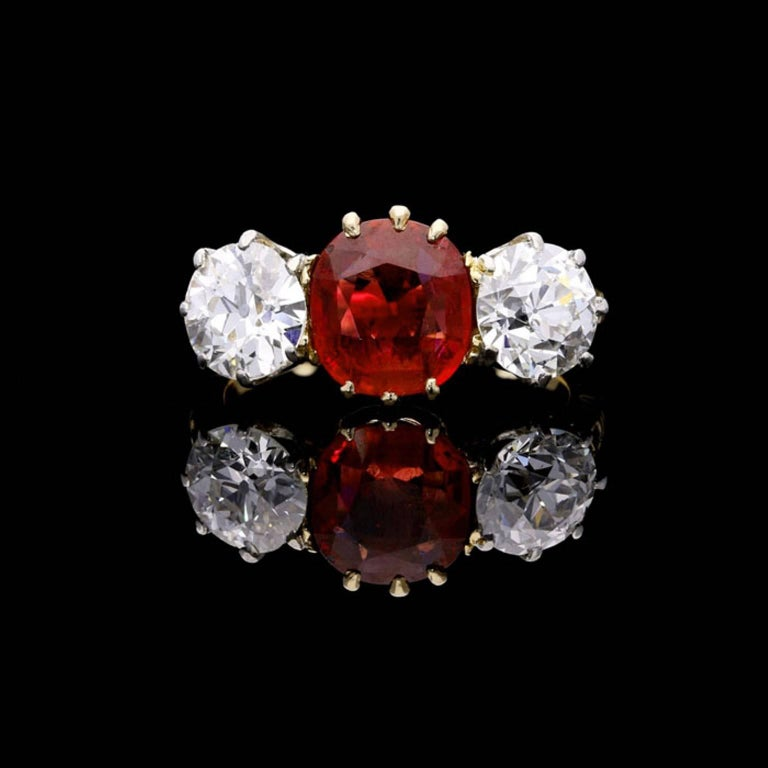 A cushion shaped ruby weighing 1.83 carats of Burmese origin accompanied by report from The Gem & Pearl Laboratory  Two old European brilliant cut diamonds weighing 1.09 carat and 0.93 carats UK finger size L, US size 6, can be adjusted to your own