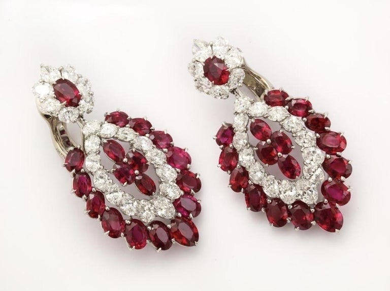 These vibrant earrings will light up the night, and forever flatter the wearer.  The combination of vivid red rubies and bright white diamonds never cease to amaze.  The 36 perfectly matched oval rubies weigh app. 30cts and the 42 oval diamonds