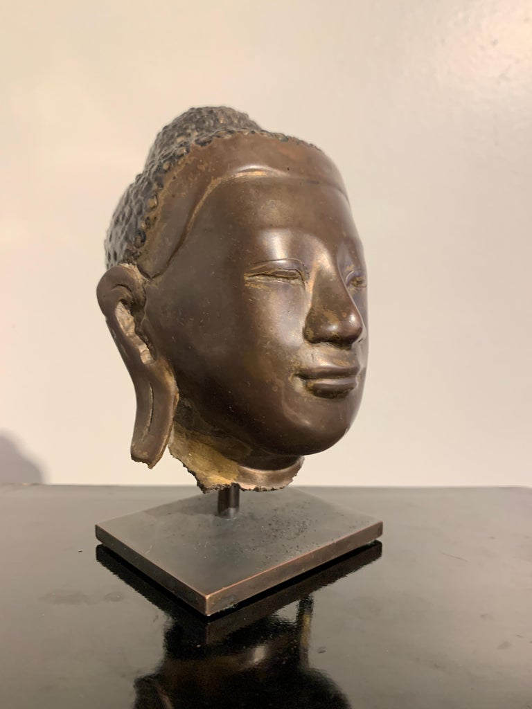 A charming Burmese Mandalay style bronze Buddha head, Mandalay period, mid to late 19th century, Burma.