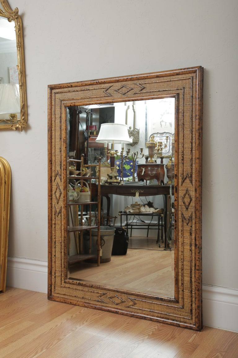 Large burnt bamboo mirror with nice details on all four sides.