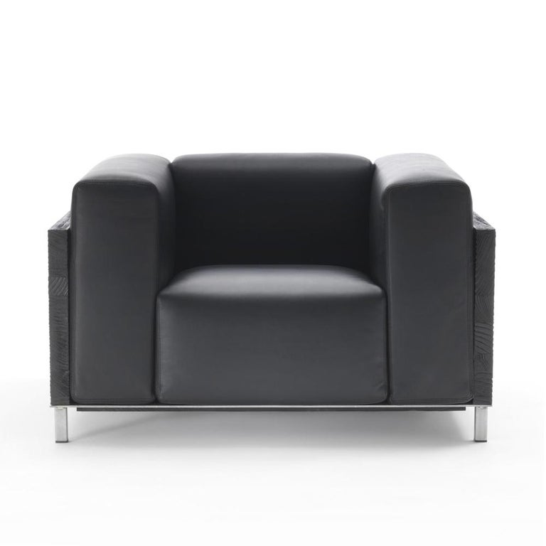 Armchair Burnt Cedar square with structure in solid burnt cedar wood, back and sides. With upholstered seat, back and sides cushions covered with high quality black genuine leather from Italy. With 4 iron feet. Also available with back and sides
