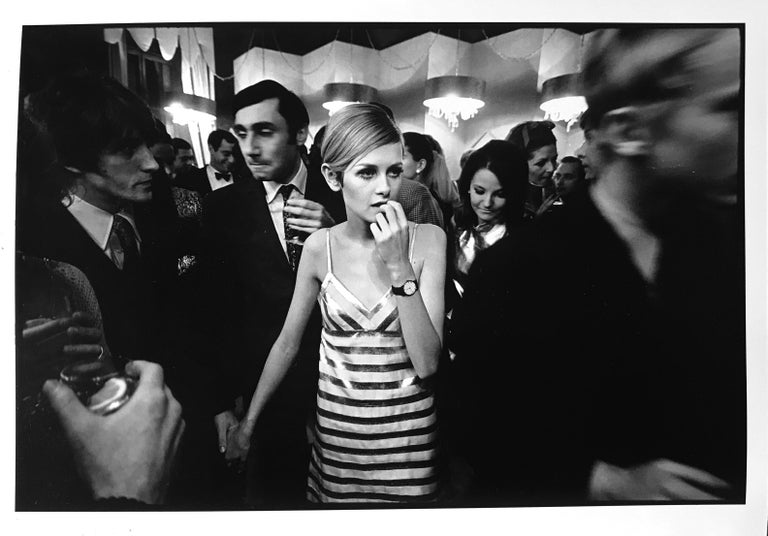 A documentary style portrait of one of the most celebrated English models of the 1960s - Twiggy. Photographed by Burt Glinn in London, England he captures the androgynous charm of the British gamine top model in a fashionable striped dress.    A