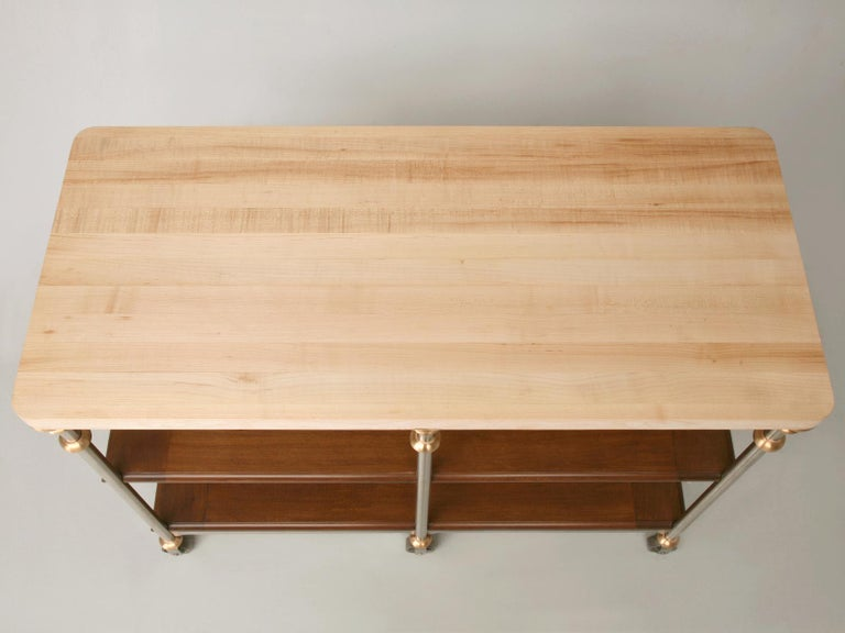 Custom made in any dimension, stainless steel and bronze kitchen island or work table, with French white oak shelves (walnut optional) and a butcher block top made in our on-site Old Plank workshop. This island can be reproduced in any size with