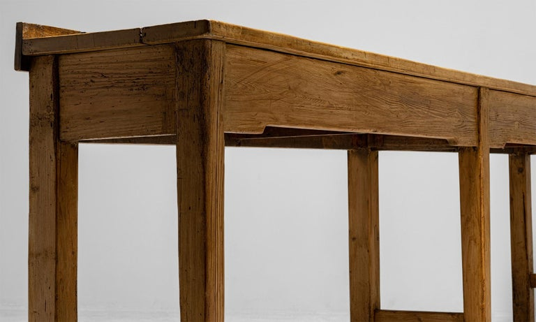 """Butchers bench work table  England circa 1890  Solid beech top with pine pegged tapered front and stout block rear legs. Sourced from a butchers shop in Balby - South Yorkshire  Measures: 115.5"""" W x 18"""" D x 37"""" H    $ 7,200."""
