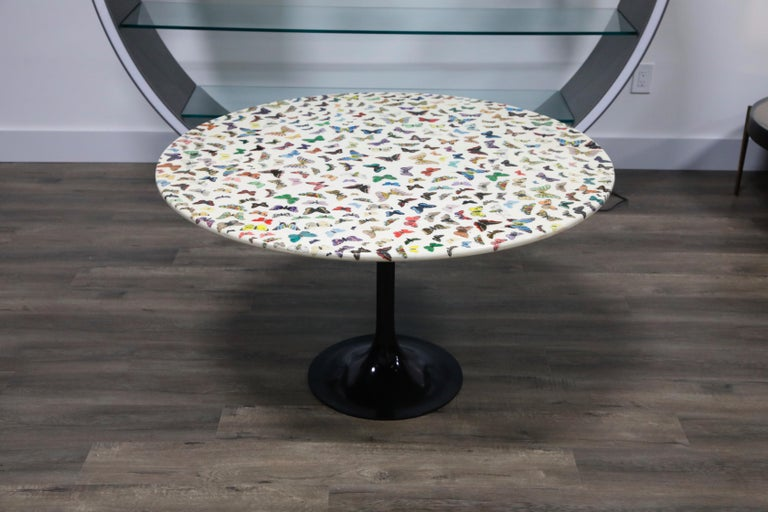 This pièce de résistance collectors item is the 'Farfalle' (translated to 'Butterflies') cafe dining table by Piero Fornasetti, circa 1960s, signed underneath with its original studio label. This round dining table (or center table) is made with