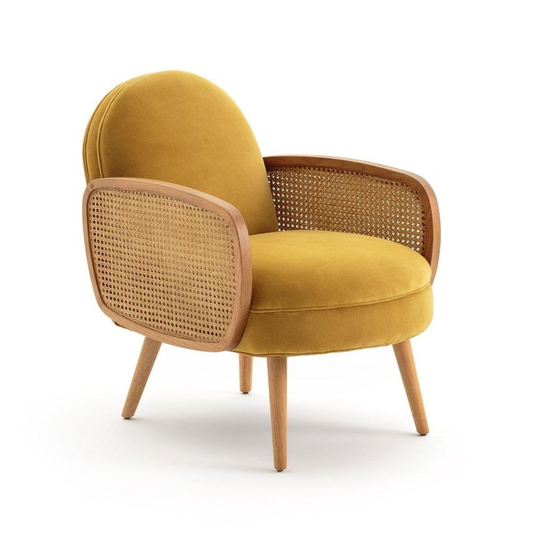 The butterfly cane armchair is handcrafted in solid wood with double natural caning inside the armrests. The rattan aesthetics combined with a wooden structure gives this armchair a refinement and a unique elegance.