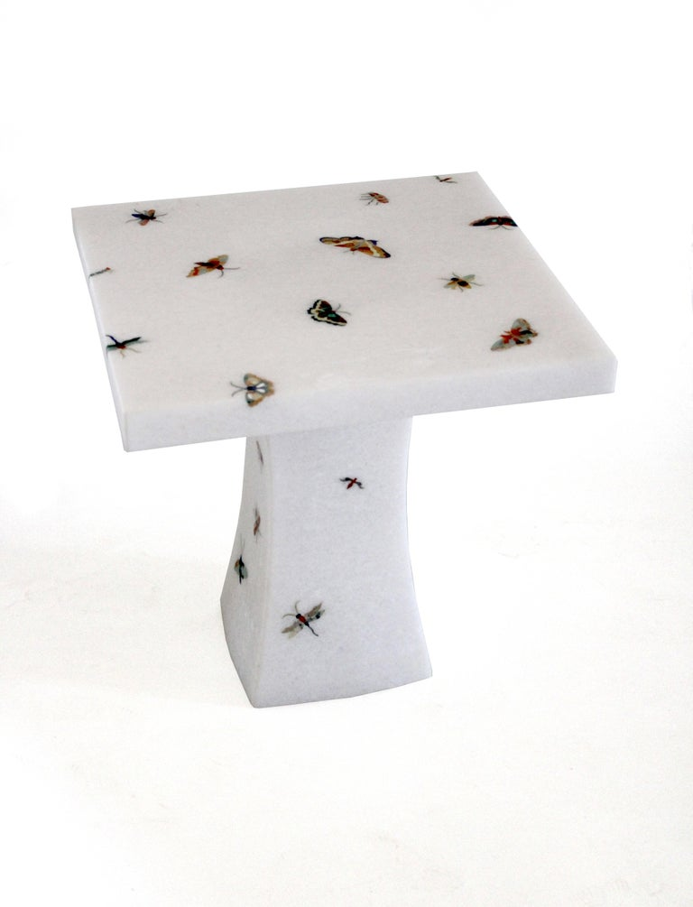 The butterfly table is a part of the Ornamenti collection. Delicately cut pieces of agate, tiger eyes, mother of pearl and other semi precious stones are made into butterfly patterns and carefully inlaid into the base stone by our master craftsmen.