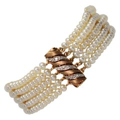 Button Pearl Multi Strand Bracelet with Gold Diamond Swirl Charm Clasp