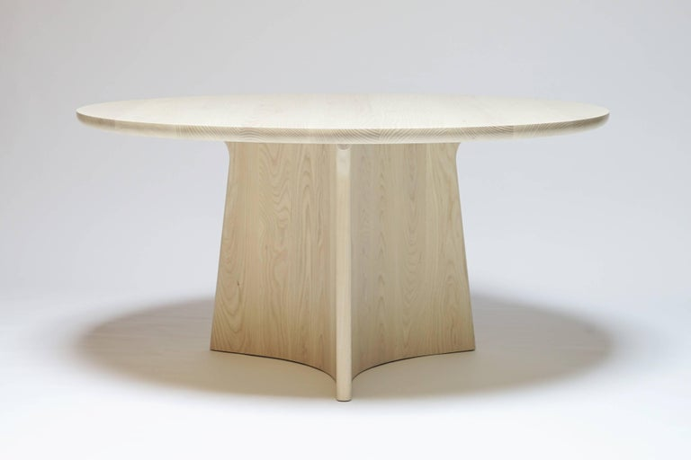 The Button dining table is a round pedestal dining table made from all solid hardwood. The hefty, three-point base means the table will not rock, while the wide overhang of the top means seats may be used anywhere around the table without