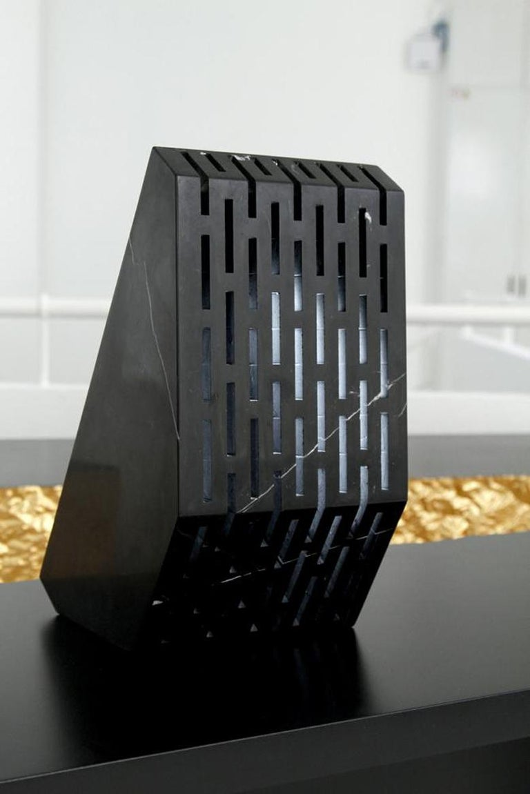 A secret light comes from the hexagonal cells of this limited edition wall lamp created in black Carrara marble. A bright crystal produced in 3D printing polymer is hidden inside the lamp. Two extremes are connected with exactitude: on one side the