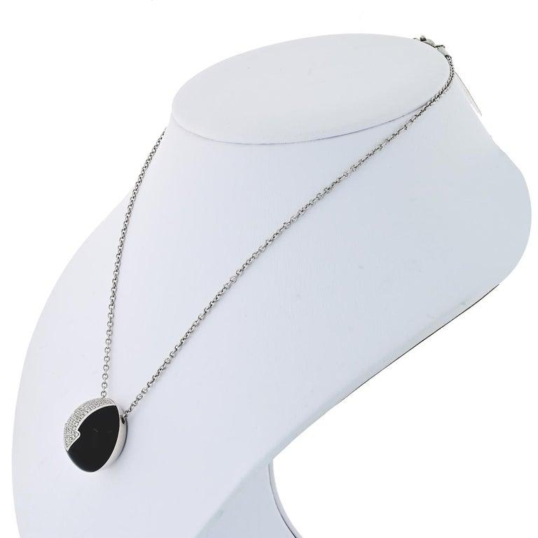 Elegant diamond Jet circle pendant by Bvlgari Gianni Enigma.   Chain: 14 inches Pendant: 0.75 inches.