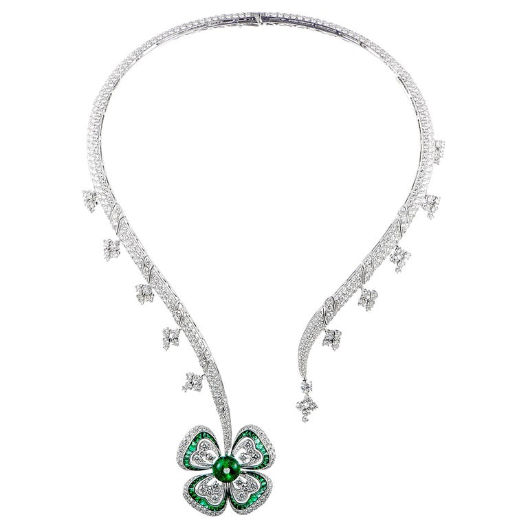 Pavé diamond, emerald and 18-karat white-gold flower pendant necklace, 21st century, offered by The Collective