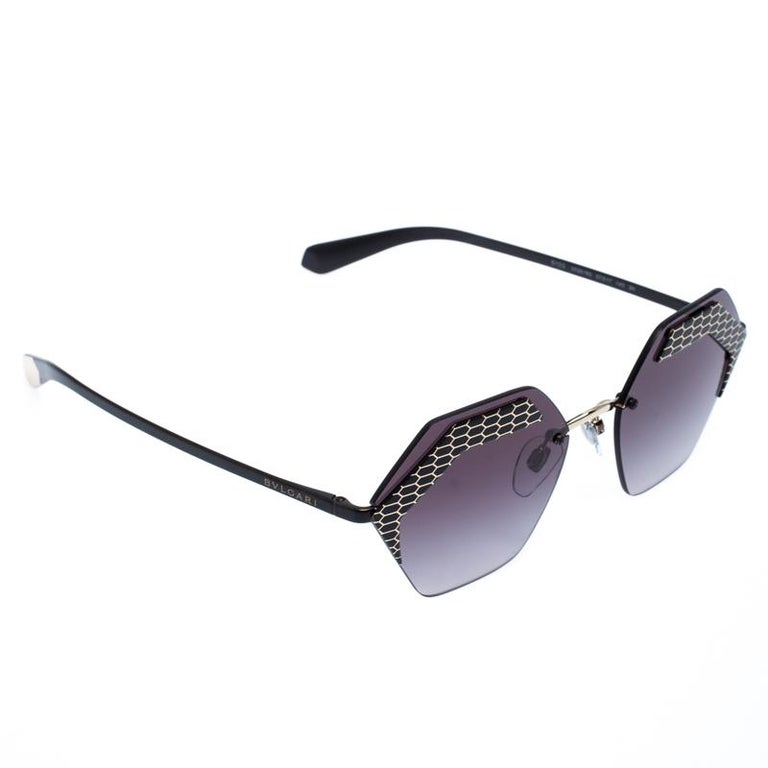 The stylish frames come from the house of Bvlgari and have been sculpted in acetate and metal to form a geometric shape and feature Serpenti accents on the front. They come with grey gradient lenses and black-tone hardware. They are finished with