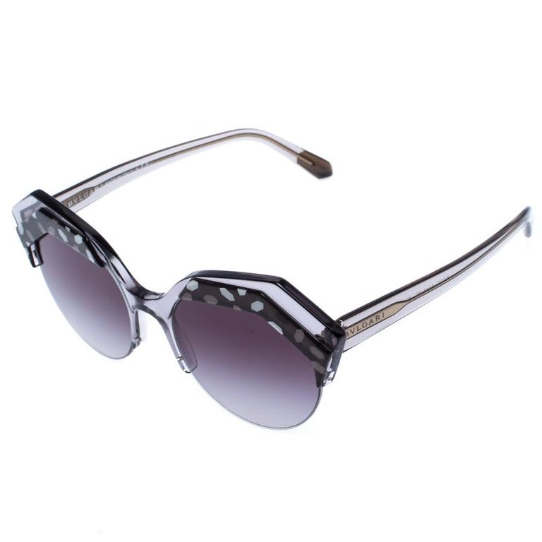 The stylish frames come from the house of Bvlgari and have been sculpted in acetate and gold-plated metal to form a round shape and feature Serpenti accents on the front. Make these sunglasses a high-fashion accessory that you must own. They come