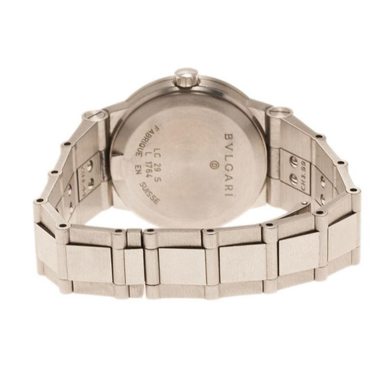 This Bvlgari watch is bold and the perfect everyday watch. Made from stainless steel, its case holds a round brushed bezel stamped with the Bvlgari logo, surrounding its black dial. Its luminous hands and hour indicators are matched with Arabic