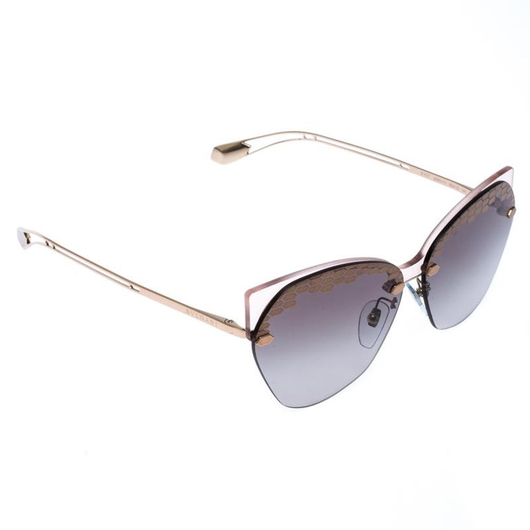 The stylish frames come from the house of Bvlgari and have been sculpted in acetate and metal to form a cat-eye shape and feature Serpenti accents on the front. Make these sunglasses a high-fashion accessory that you must own. They come with grey