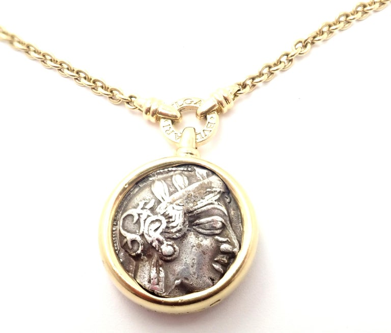 18k Yellow Gold Ancient Greek Coin Link Necklace by Bulgari.  This necklace comes with an original Bulgari box.  With 1 Ancient Coin Attica - Atene 449-404 b.c. Details:  Necklace is 36