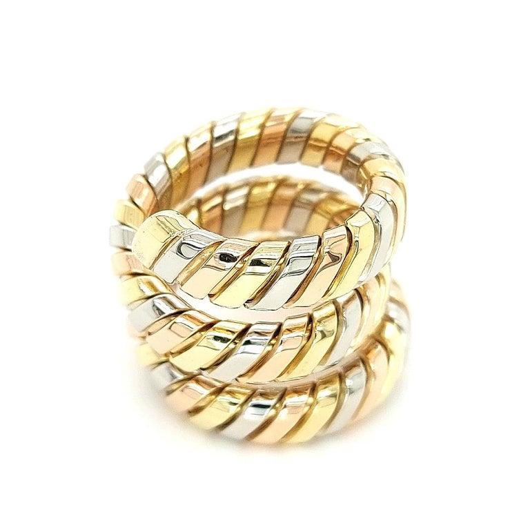 Bvlgari Bulgari Tubogas 18k Yellow, White, Rose Gold Flexible Wrap Band Ring  Bvlgari - Bulgari Tubogas 18k Tri Color Gold Wrap Band. This authentic Bvlgari piece is finely crafted from 18k yellow, white and rose gold. It comes from Bulgari Tubogas