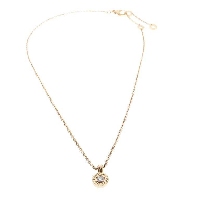 This gorgeous necklace from Bvlgari is an expression of elegance and subtle charm. It is sculpted in 18k rose gold and is centered by a gold ring engraved with twin logos, inspired by the inscriptions on the ancient coins, and is framed by a round
