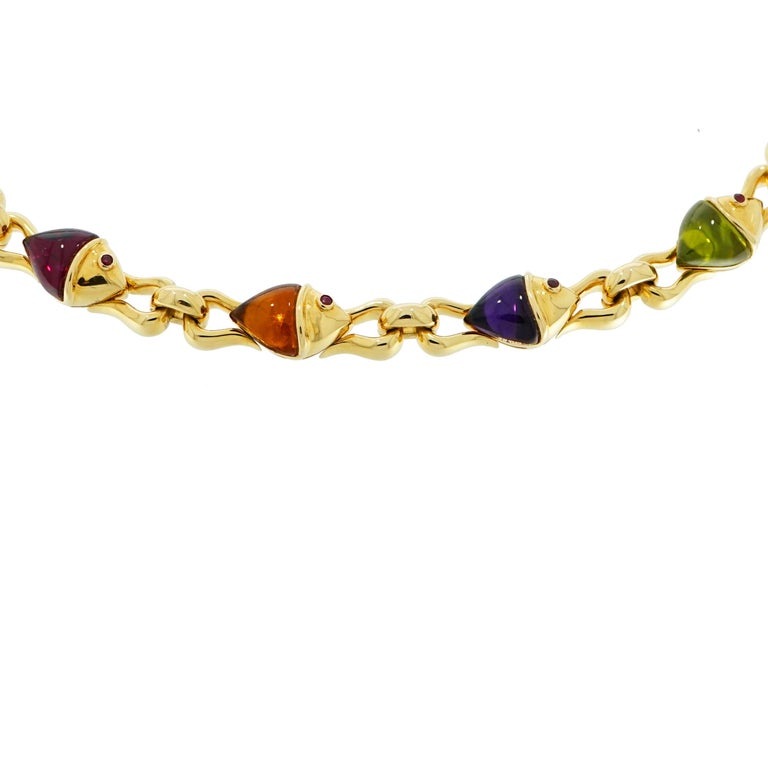 This previously loved necklace is from Bvlgari's signature Naturalia collection. A gorgeous necklace that features colorful fish design.  Crafted in a high polished 18 karat yellow gold forming beautiful rounded links connecting seamlessly each fish