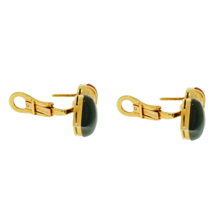 This previously loved pair of earrings is from Bvlgari's signature Naturalia collection. Features colorful fish design crafted with cabochon cut Green Tourmaline, Citrine and Diamond accent. Set in a high polished 18 karat yellow gold and has the