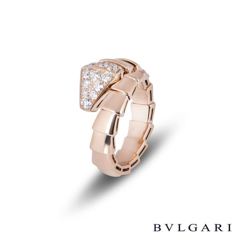 An 18k rose gold diamond ring by Bvlgari from the Serpenti collection. The ring is in the form of a serpent wrapping around the finger, comprising 17 graduating flexible intersections including the diamond set head of a snake. The head has 15 round