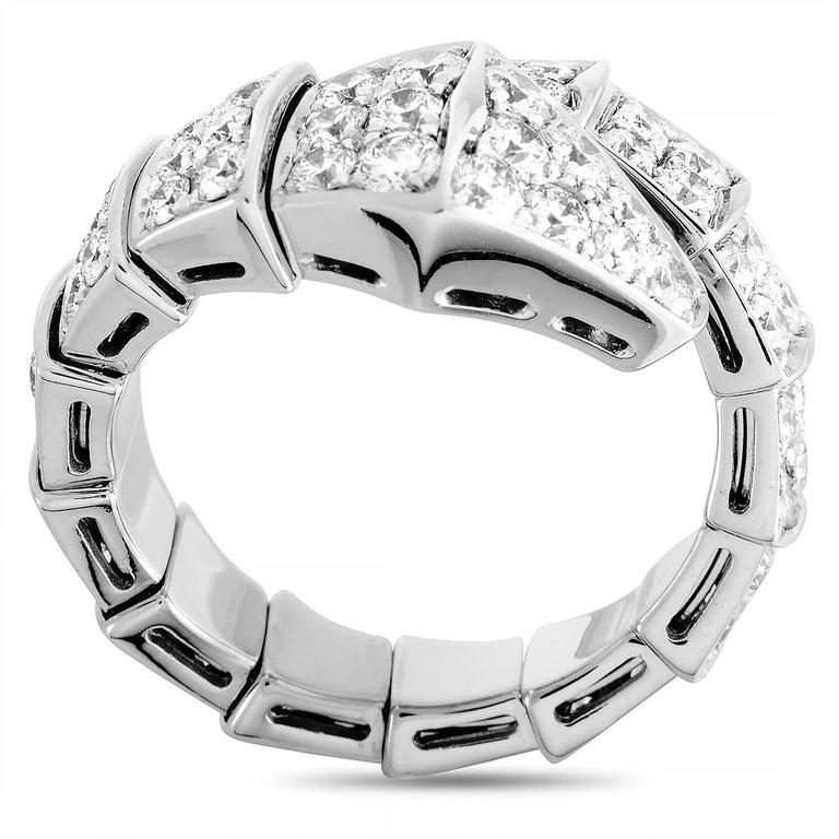 """The Bvlgari """"Serpenti"""" ring is made out of 18K white gold and diamonds and weighs 8.7 grams. The ring boasts band thickness of 5 mm and top height of 5 mm, while top dimensions measure 13 by 20 mm.  This jewelry piece is offered in brand new"""