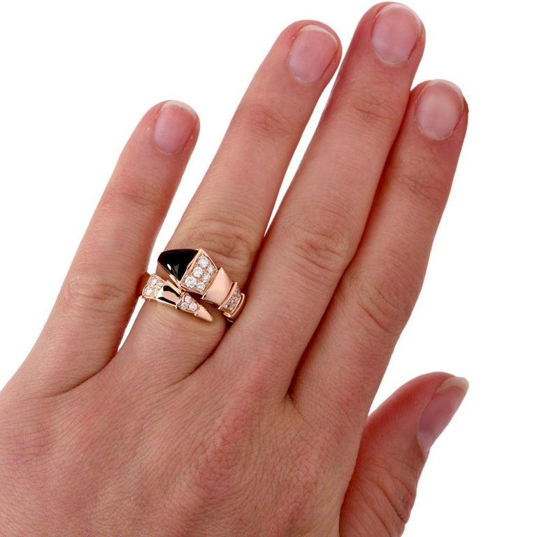 A Bvlgari Serpenti ring crafted in 18K pink gold with onyx inlays and 24 round diamond accents. Approx. 1.00 carats E-F color VS1 in stock in like new condition. Current Retail Price is $9700.00. This Bulgari ring is in exceptional condition offered