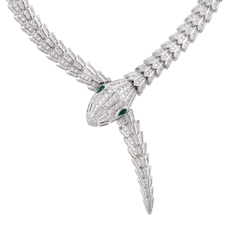 Bulgari Serpenti diamond snake necklace with emerald eyes in 18k white gold, accompanied by Bulgari box and Bulgari certificate of authenticity.  This necklace contains approximately 37.13 carats of round diamonds, and is accented with 2 pear shape