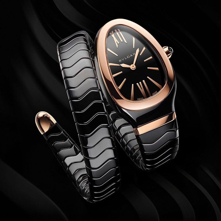 Serpenti Spiga Watch  Ref . 102735  Serpenti Spiga single spiral watch with black ceramic case, 18 kt rose gold bezel, black lacquered dial and black ceramic bracelet set with 18 kt rose gold element Size : 35mm Movement : quartz Cellini NYC offers