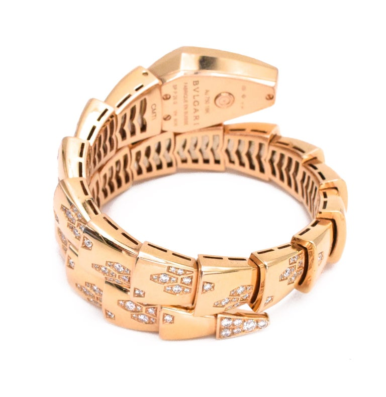 Bvlgari Serpenti Bracelet/Wristwatch In Coiled Rose Gold, Mother-of- Pearl and Diamond 18 kt., quartz, composed of polished tapered scales accented by round diamonds approximately 2.50 carats tipped by a fancy- shaped snake head with mother-of-pearl