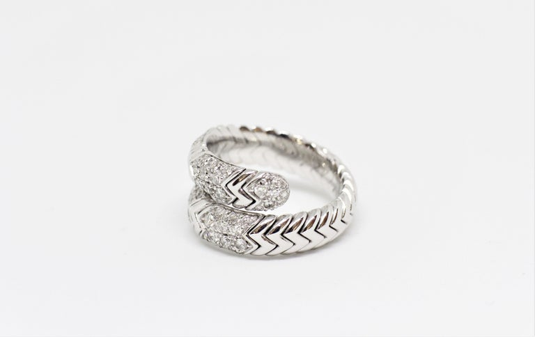 Bulgari Spiga ring set with round brilliant cut diamonds in a grain setting with an approximate weight of 0.75 carats. The ring is twisted with a flexible zig zag snake-like design. Marked Italy BVLGARI 18K. UK finger size 'N'.