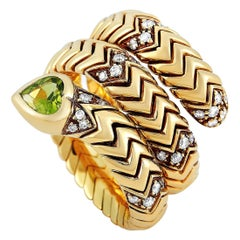 Bvlgari Spiga 18 Karat Yellow Gold 0.20 Carat Diamond and Peridot Ring